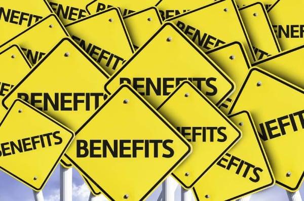 Benefits written on multiple road sign - Hubspot perks