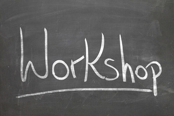 Workshop word in white chalk handwriting on the blackboard