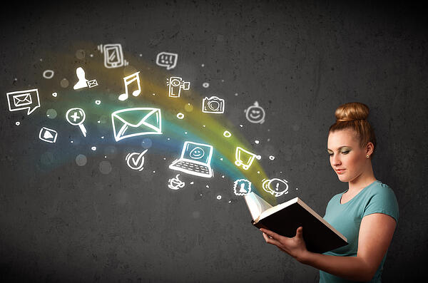 Young lady reading a book with multimedia icons coming out of the book